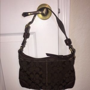Brown coach purse 3 years old